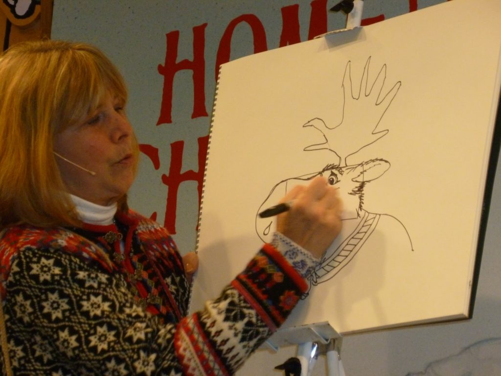 Jan Brett drawing a moose