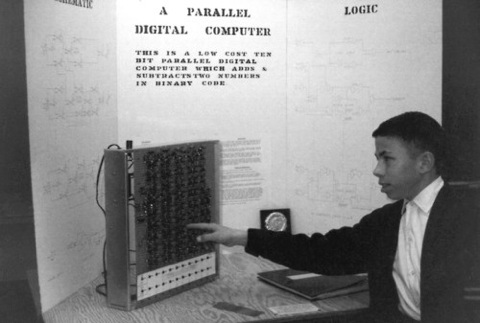 Wozniak at thirteen showing off his science-fair-winning Adder/Subtractor